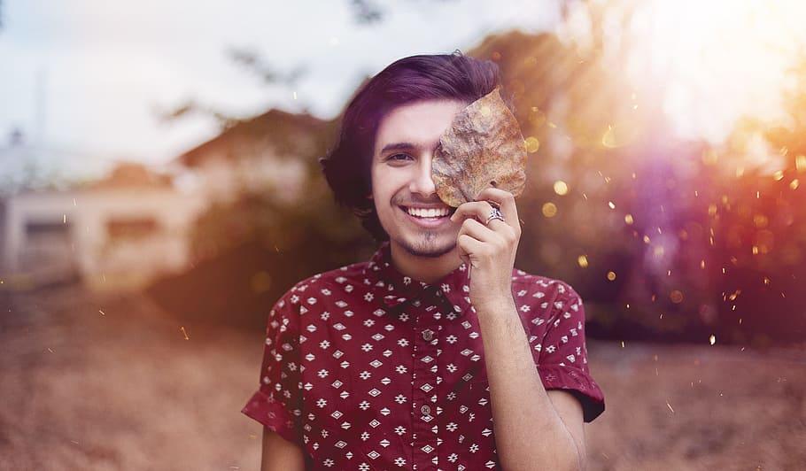 Boy Smiling With Leaf